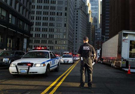 New York Police Department Inspector James Kehoe stands in the street and directs a Critical Vehicle Response deployment in New York August 24 2011