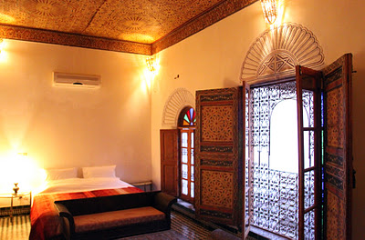Four guest bedrooms are decorated in different styles