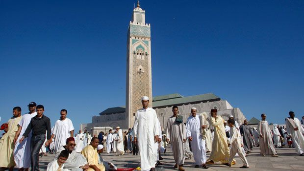 People leave King Hassan II Mosque in Casablanca after the Eid prayer (Photo by AP)