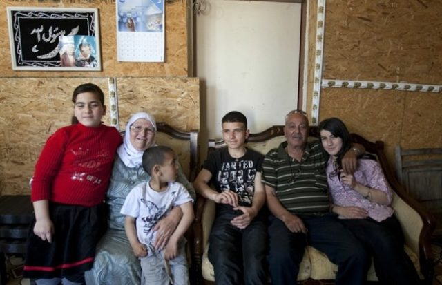 Helen Brashatsky, who converted to Islam after surviving the Holocaust, poses for a photo with her husband of Palestinian descent, Ahmad Jabarin, and their grandchildren on April 17, 2012 at their home in the Arab -Israeli city of Umm al-Fahm where she has lived for 50 years. (AFP PHOTO/AHMAD GHARABLI)