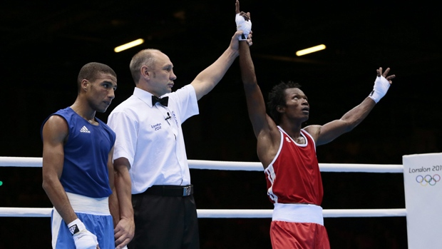 Cameroon's Thomas Essomba, right, reacts after defeating Morocco's Abdelali Daraa during their men's light fly 49-kg boxing match at the 2012 Summer Olympics on July 31. AP