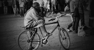 Man in the city of Marrakech riding a bicycle