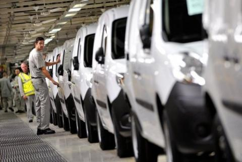 Employees work on a production line at the MCA Renault plant in Maubeuge, northern France on October 8, 2012. AFP