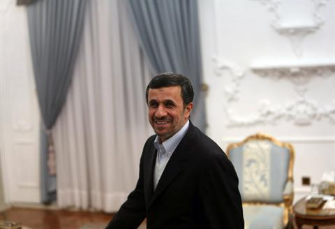 Iranian President Mahmoud Ahmadinejad smiles as he attends a meeting with Syrian Prime Minister Wael al-Halaqi in Tehran on January 15 AFP