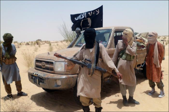 AQIM's goal of establishing a foothold In Mali came through an alliance with Ansar al-Din fighters, shown here near Timbuktu. [AFP-Romaric Ollo Hein]
