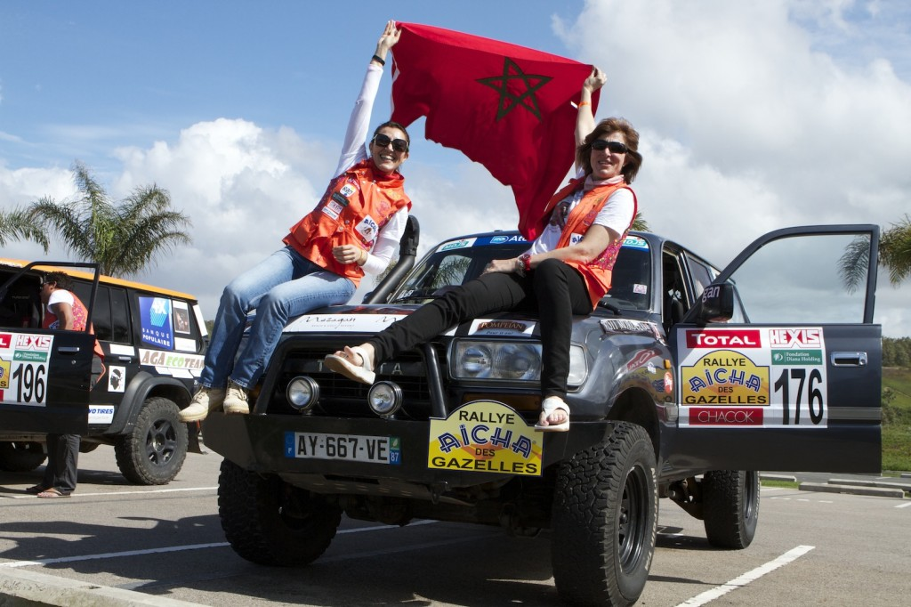 Benedicte Clarkson and Jamila Ait'Akka waving the Moroccan flag (Picture by Helene Clemenson for Morocco World News)