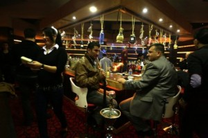 Customers enjoy the view from the rooftop bar of Baghdad's Palestine Hotel, on February 9, 2013 (AFP-File, Patrick Baz)