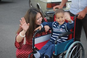 Doha Benchkhchou, the founder of Project '1001 Wheelchairs for 1001 Smiles' with one recipient of the wheelchair
