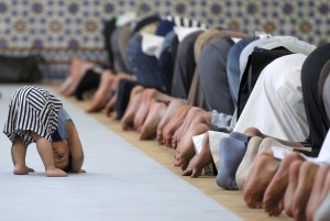 Photo of child imitating prayers in a mosque chosen best picture of the week