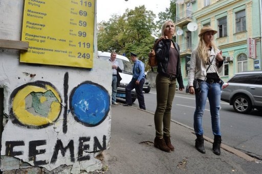 Activists from Ukrainian feminist movement FEMEN, Oleksandra Shevchenko (left) and Yana Zhdanova, outside the organisation's office in Kiev