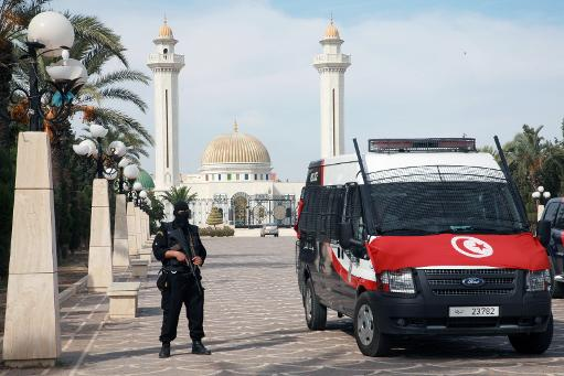 A Tunisian security guard stands near a police vehicle in front of the tomb of Tunisia's independence leader Habib Bourguiba (AFP, Bechir Bettaieb)