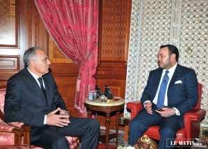 Morocco's Foreign Minister Salah Eddine Mezouar with King Mohammed VI