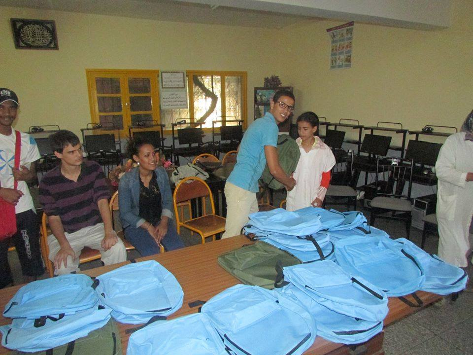The American Language Center in Fez donating school bags for young Moroccan students in Fez. Photo by Yahya Bouhafa for Morocco World News