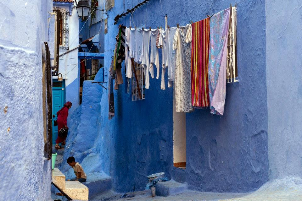 Moroccan Women Entering her house in Chefchaouen