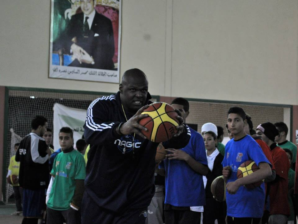 Adonal Foyle, former center for the Orlando Magic, teaches young Moroccans the fundamentals of basketball in Azrou.