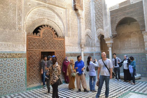 Tourists sightseeing Mederssa of Attarine in fez Morocco