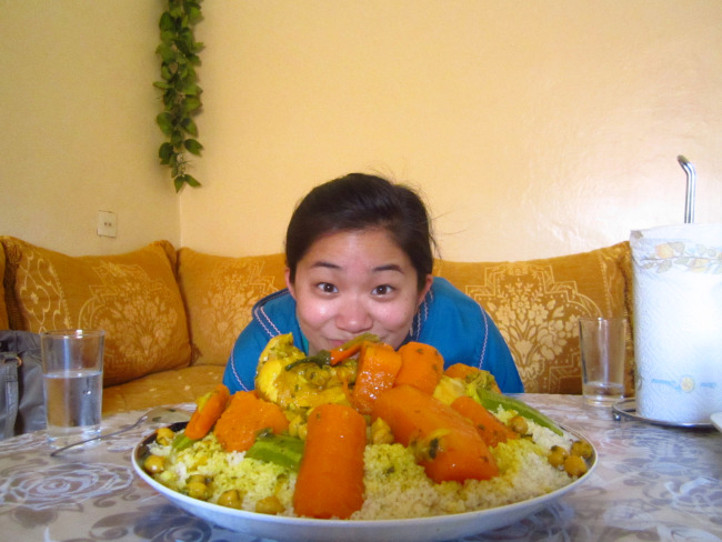 Jaclyn Dean in  a picture with Moroccan couscous