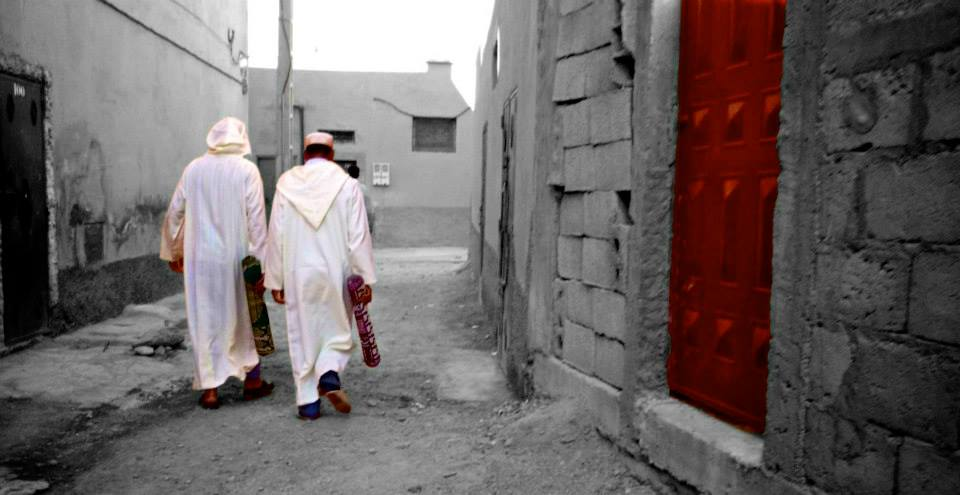 Moroccan men walking to the nearby mosque