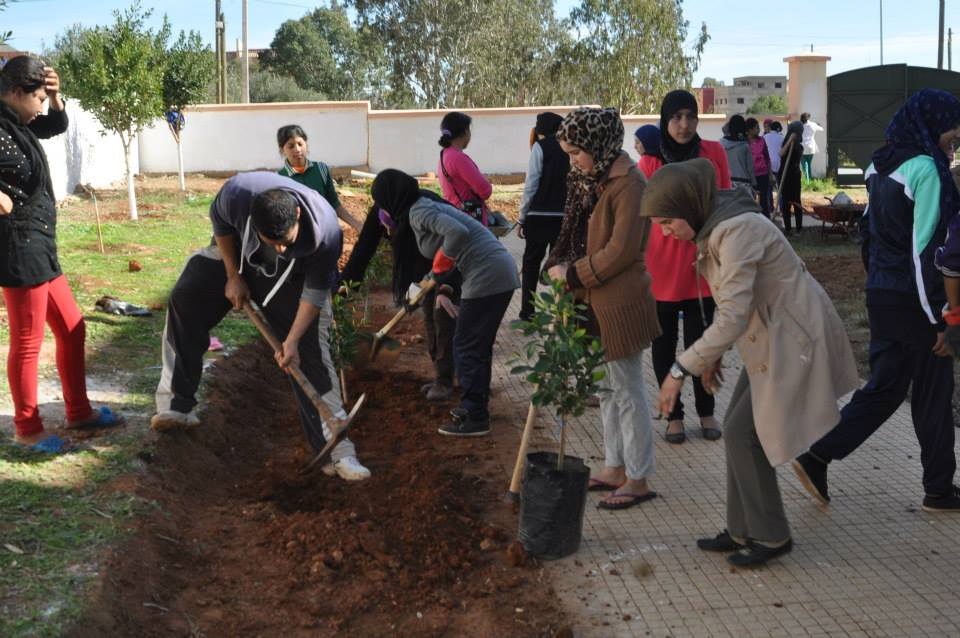 The International Youth Foundation's Passport to Success Program at Dar Taliba-Zaio, girls and boys planting trees