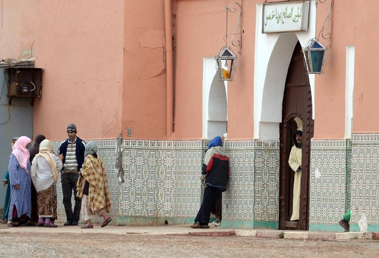 Local residents are seen standing outside the shrine of Bouya Omar, in the village of the same name, some 86 km east of Marrakesh, on March 20, 2014 (AFP Photo:Fadel Senna)
