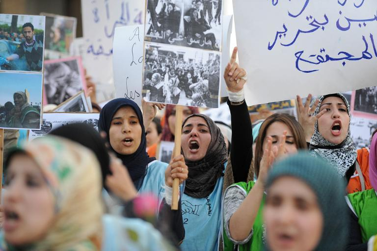 Moroccan women shout slogans as they take part in a rally marking the International Women's Day