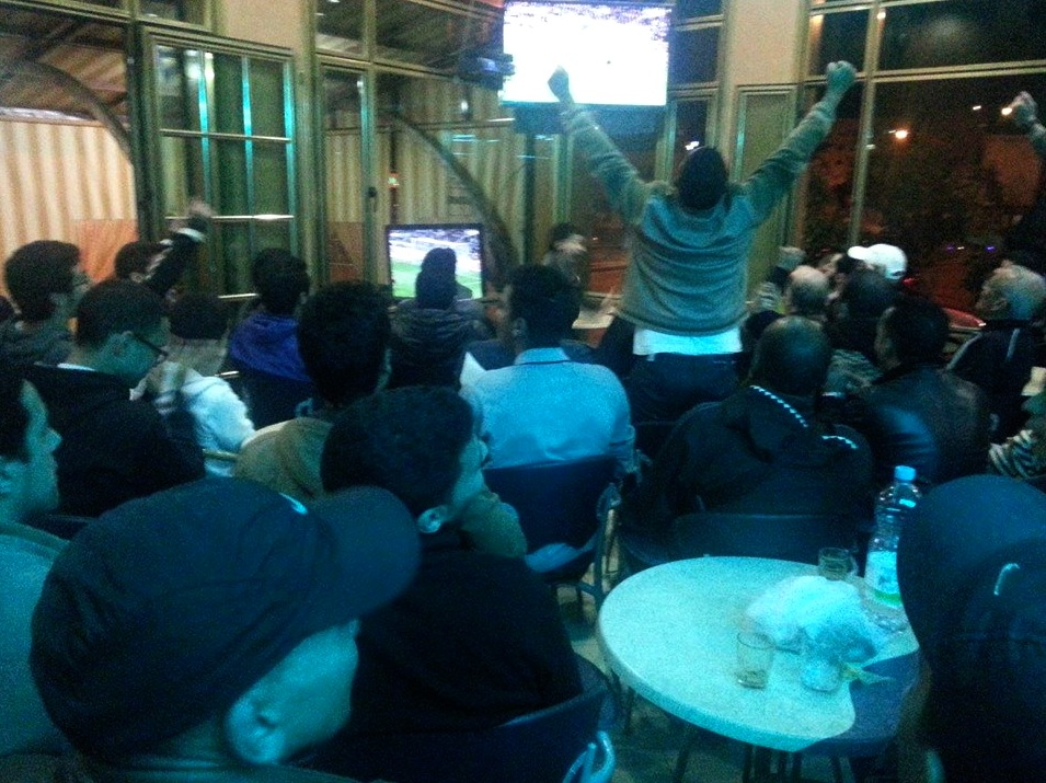 Moroccan football fans watch the Classico game between Real Madrid and F.C. Barcelona in cafe