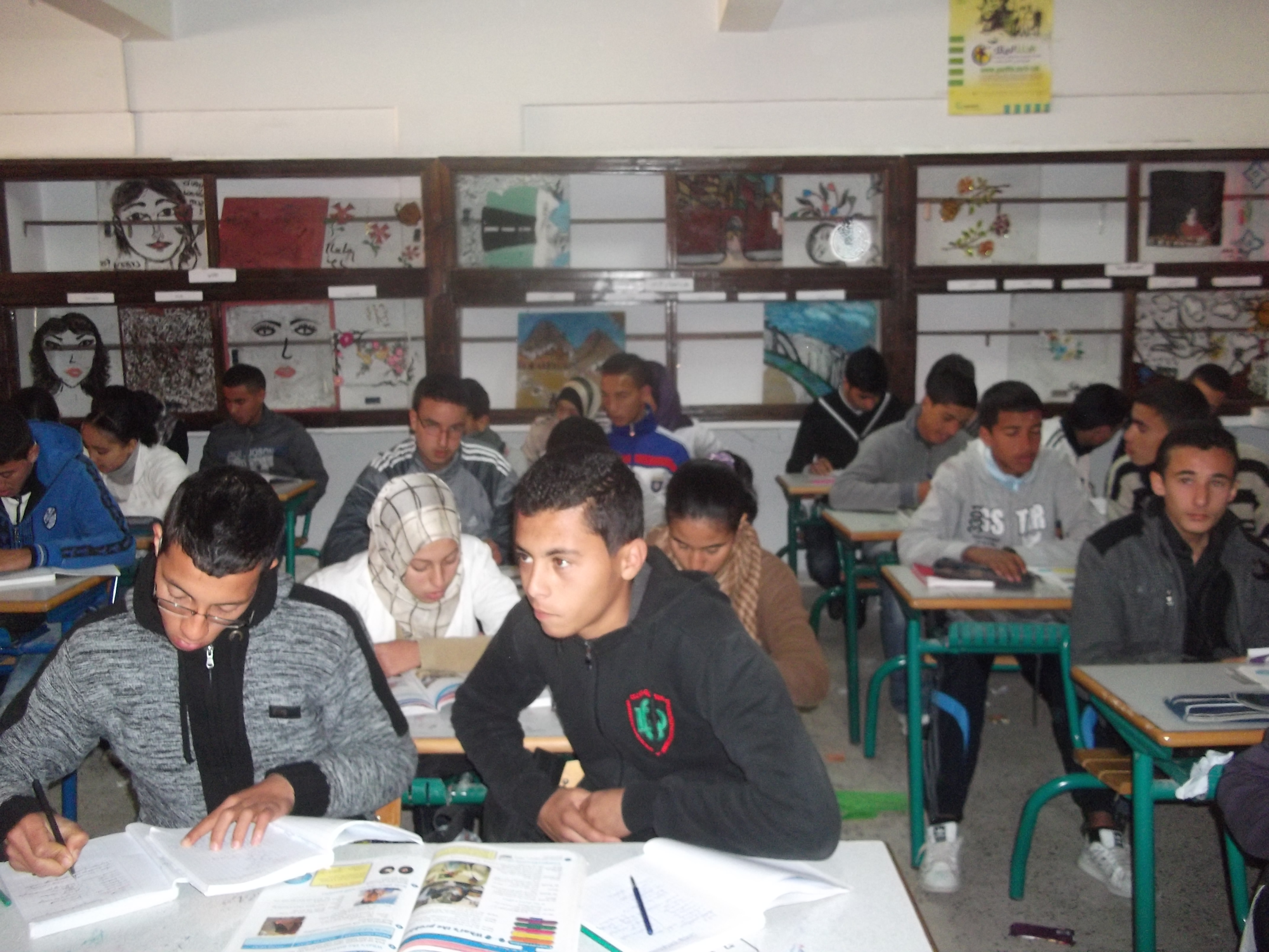 Students in a classrom in Morocco (Photo by Izza Fartmis)