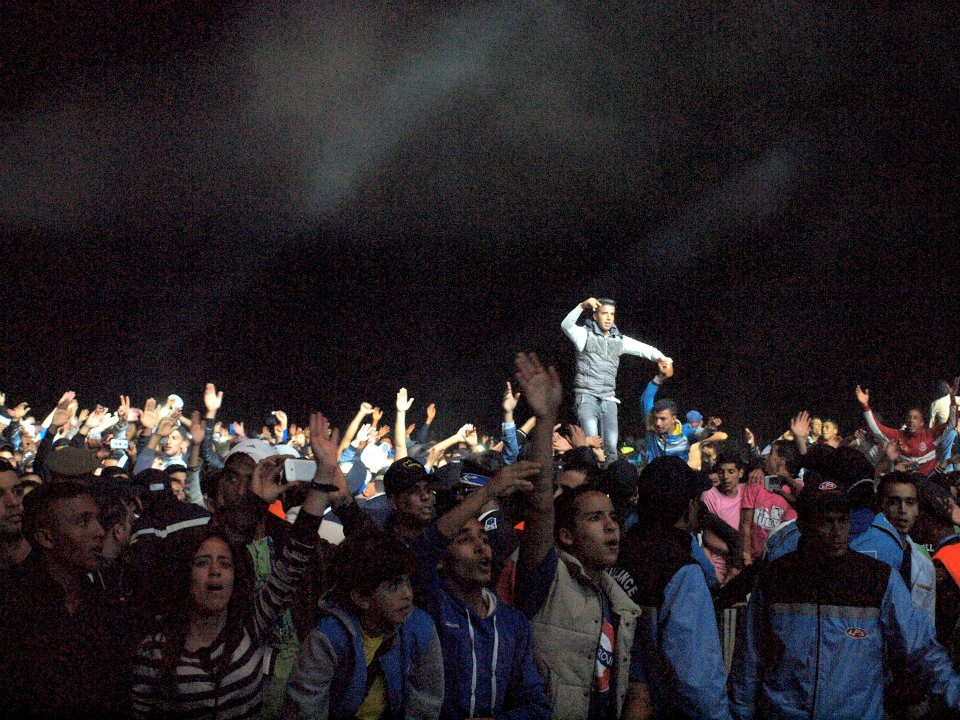 Moroccan music fans during the performance of Moroccan Rapper Muslim in Sale. Photo by Melissa Smyth