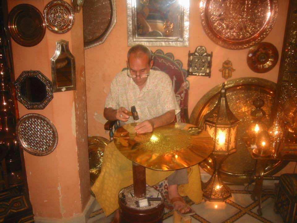 Craftsman in Fez preparing silver articles