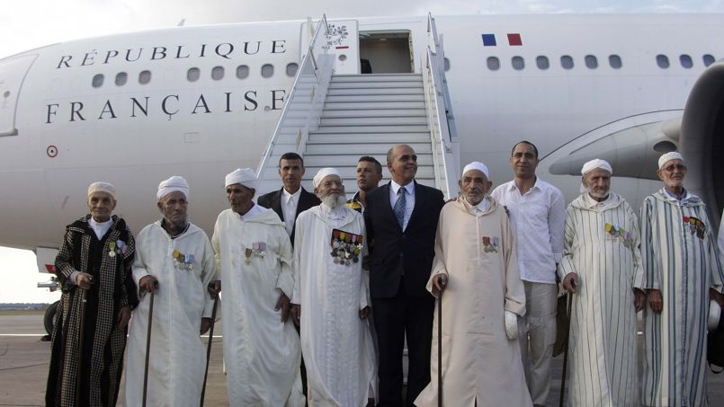 French Junior Minister for Veterans Arif poses with Moroccan veterans in Rabat