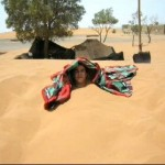Larbi buried in the sand
