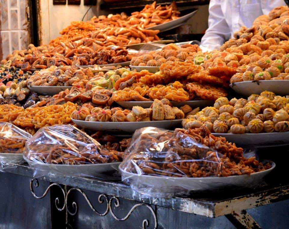 Moroccans eat sweets [Chabbakiya] with Harira
