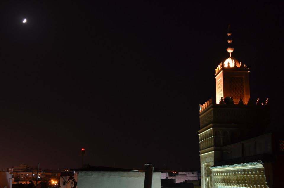 The moon enlighten the minaret of this mosque inside de ancient Medina of Rabat