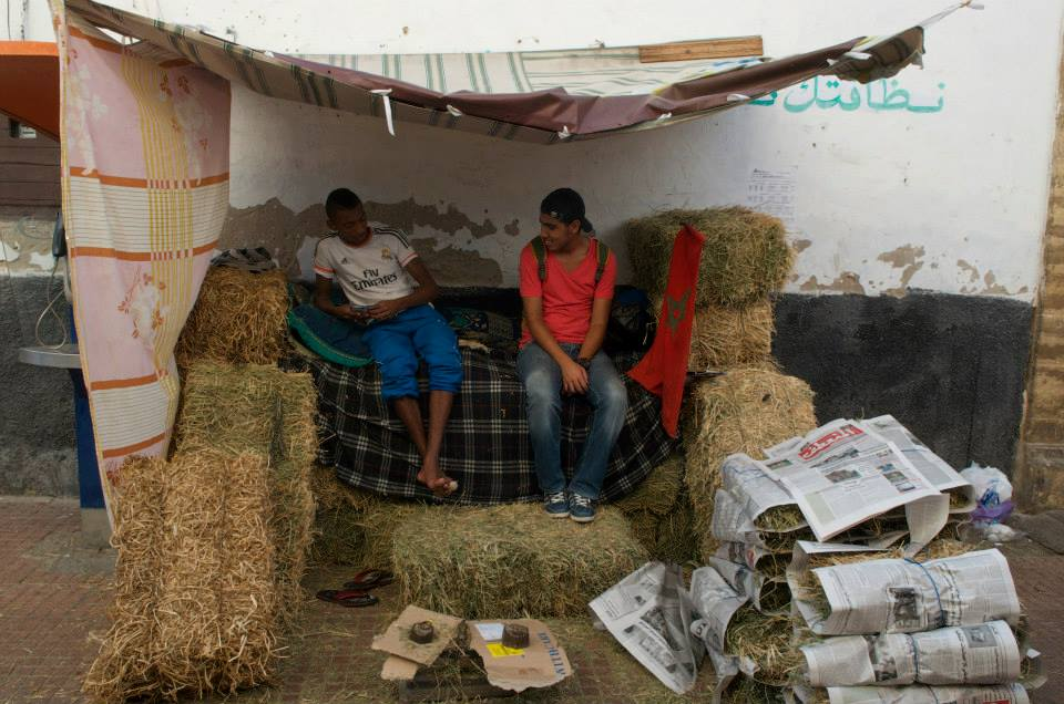 A week before Eid, some people sell grass silage to feed the sheep on the terraces of their houses