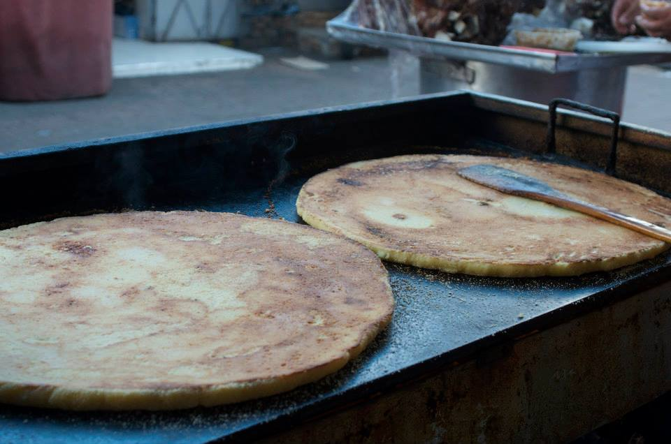 It is a flat bread made from semolina that taste like corn, crusty outside and soft inside. These circles are roasted in large plates and a quarter of one can be bought for 5 dirhams.