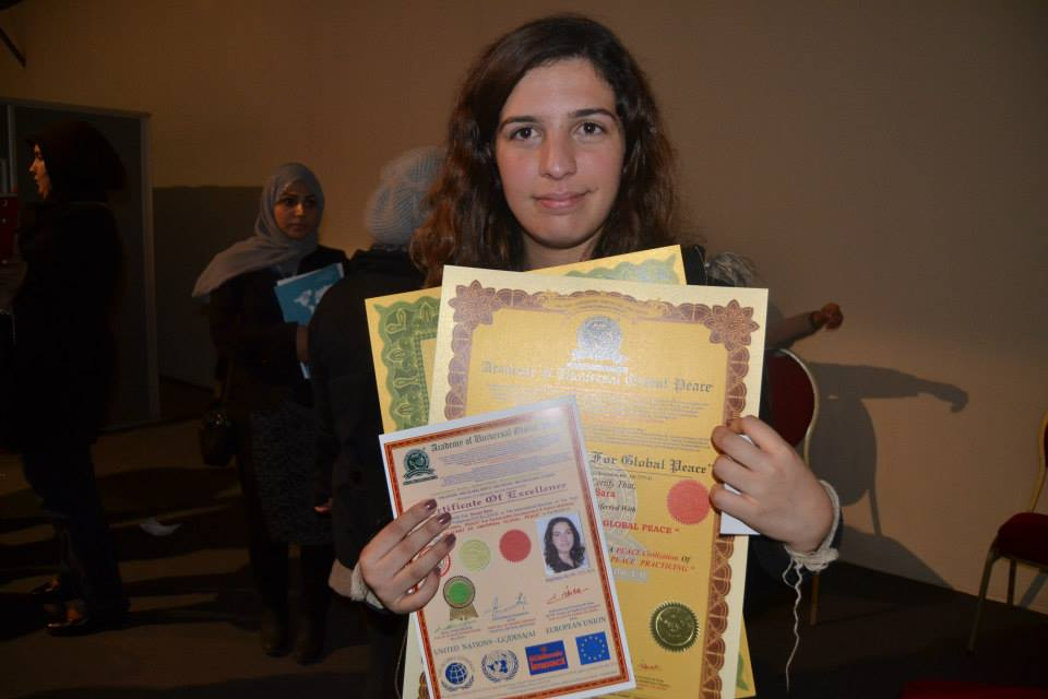 Sara Soujar receiving her Excellence for Peace Certificate