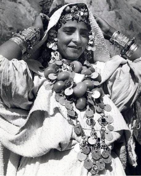 A Young woman from Tafraout wearing traditional Amazigh dress and jewelery