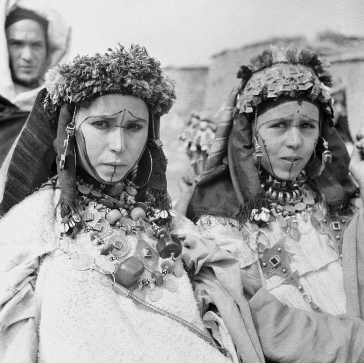 Young Women, from Ida Ou Zekri tribe in Souss region, with tattooed faces, a common practice in Amazigh culture