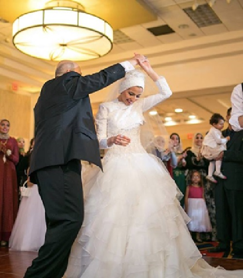 """Dancing with Daddy."" - Yussor Abu-Salha's Facebook post of her wedding day in December 2014."