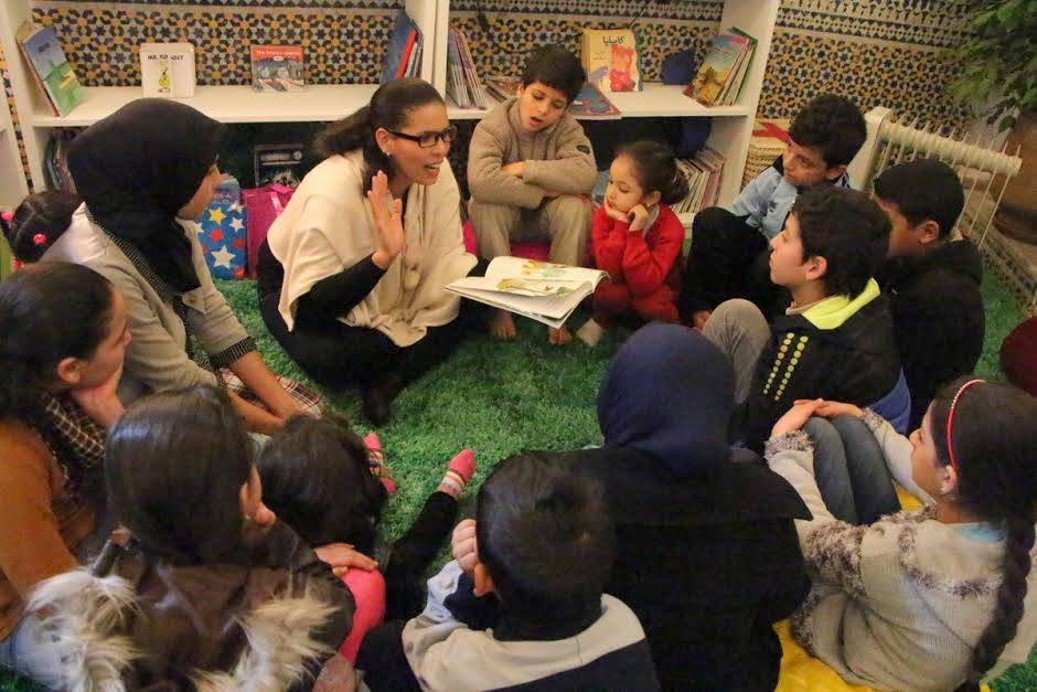 Aicha Morelli, one of the daily volunteer story readers.
