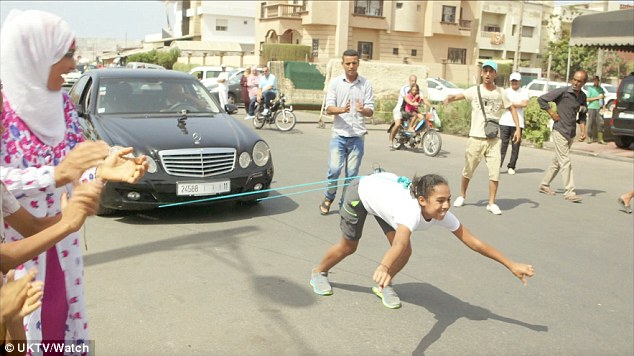 moroccan girl pulls car with her hair