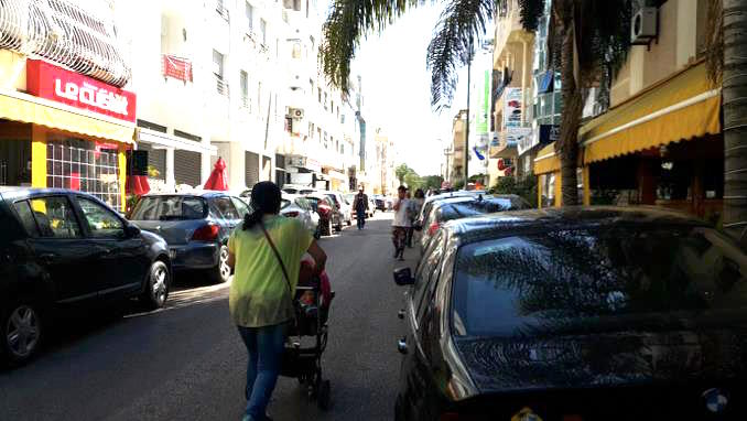 Cafés and cars occupy the sidewalk in Agdal, Rabat and pedestrians are unlawfully pushed in the narrow roads at the mercy of crazy drivers (Photo: Dr. Mohamed Chtatou)