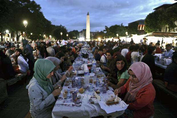 Thousands of Turkish people break their fast at the Blue Mosque square in Istanbul.