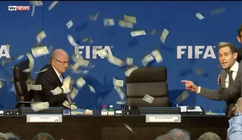 Video: Lee Nelson Throws Fake Dollars on Seep Blatter