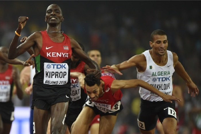 """Kenya's Asbel Kiprop, Morocco's Abdalaati Iguider and Algeria's Taoufik Makhloufi sprint to the finish line in the final of the men's 1500 metres athletics event at the 2015 IAAF World Championships at the """"Bird's Nest"""" National Stadium in Beijing on August 30, 2015. AFP PHOTO / OLIVIER MORIN"""
