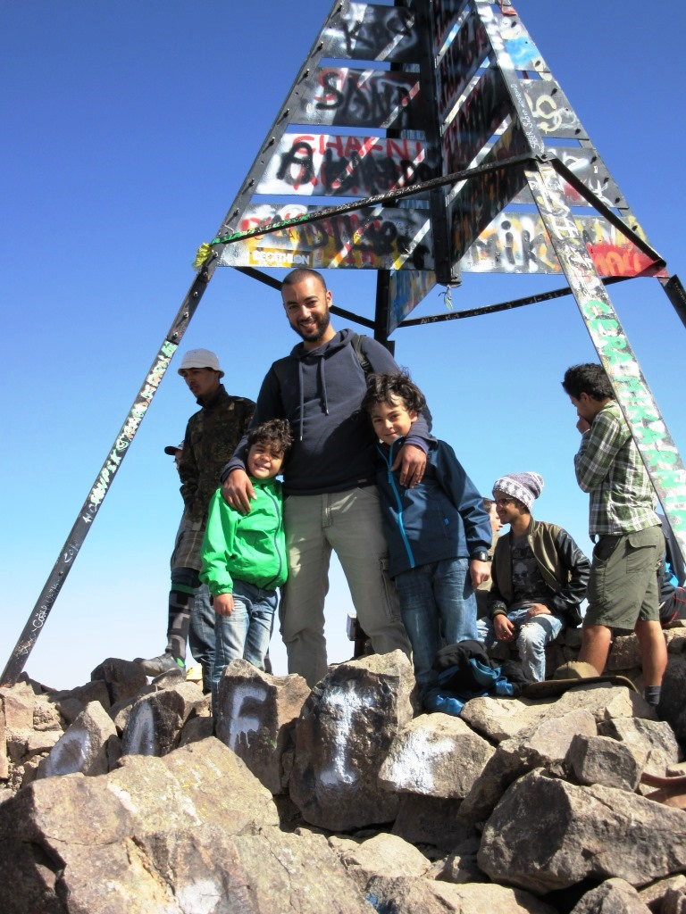 Yanis and Adam Oulad with thei father on the top of Toubkal Mountain
