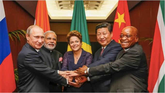 "Brazil, Russia, India, China, and South Africa known collectively as the BRICS, celebrate the birth of the new development bank: ""The BRICS Development Bank""."