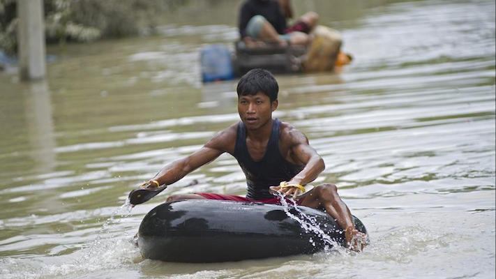 Flood-affected residents use make-shift rafts to travel through floodwaters in Kalay, upper Myanmar's Sagaing region on Aug. 3, 2015. (Ye Aung Thu/AFP/Getty Images)