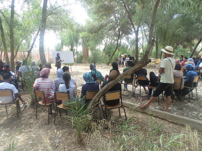 Meriam Bentaleb teaching campers public speaking skills in the open air