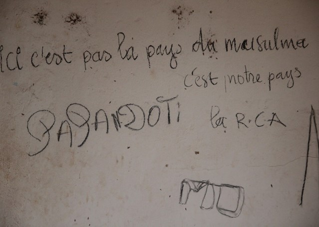 This isn't the Muslims' country, this is our country graffiti written on the wall of a destroyed mosque in Carnot, Central African Republic